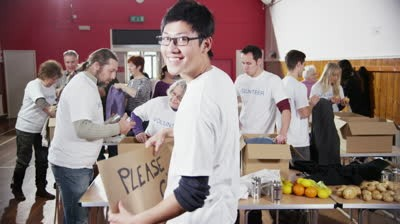 b2ap3_thumbnail_stock-footage-a-male-charity-volunteer-of-asian-ethnicity-holds-up-a-thank-you-sign-and-smiles-at-the-camera-as.jpg