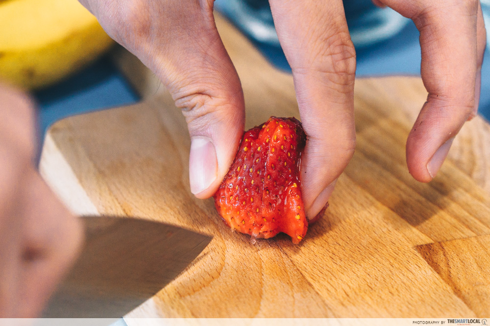 cutting strawberries for our dessert