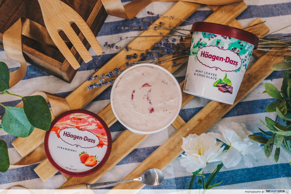 haagen dazs ice cream mint chocolate and strawberry flatlay