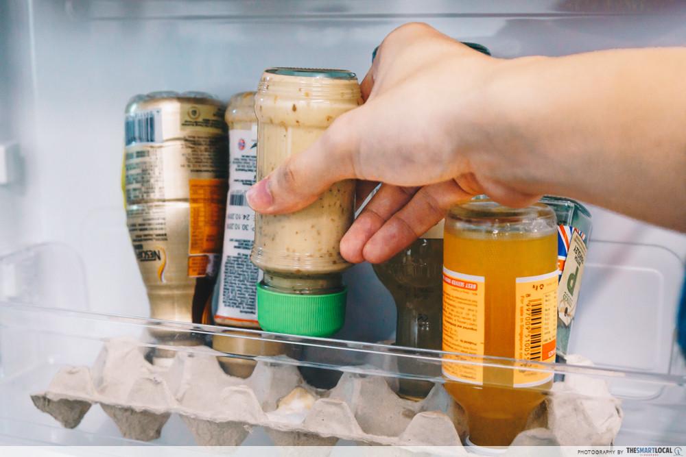 upside down bottles in fridge