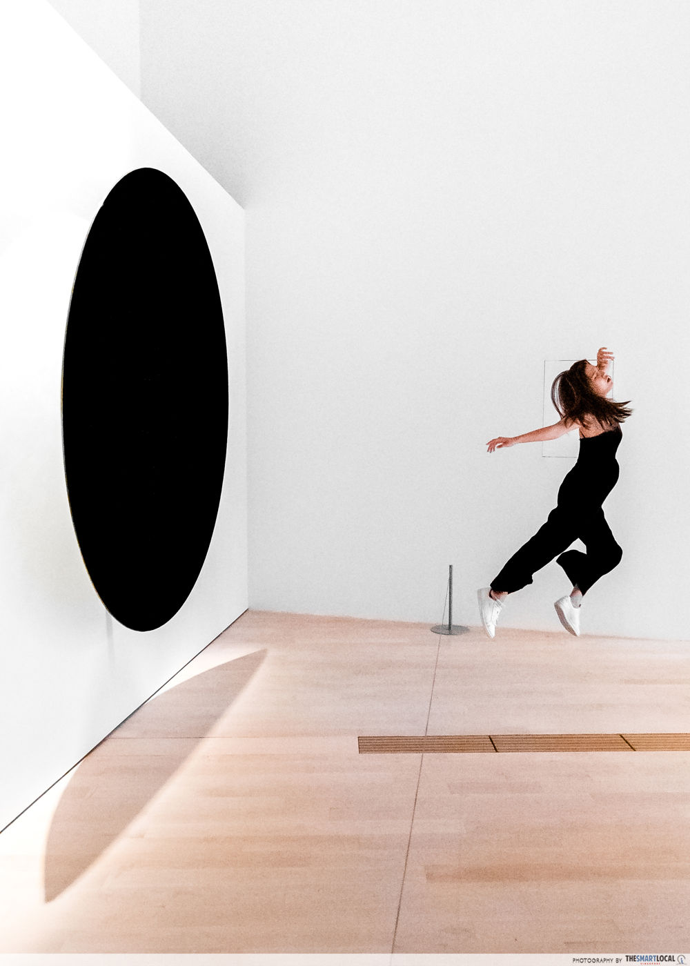 model appearing to be sucked into a black hole