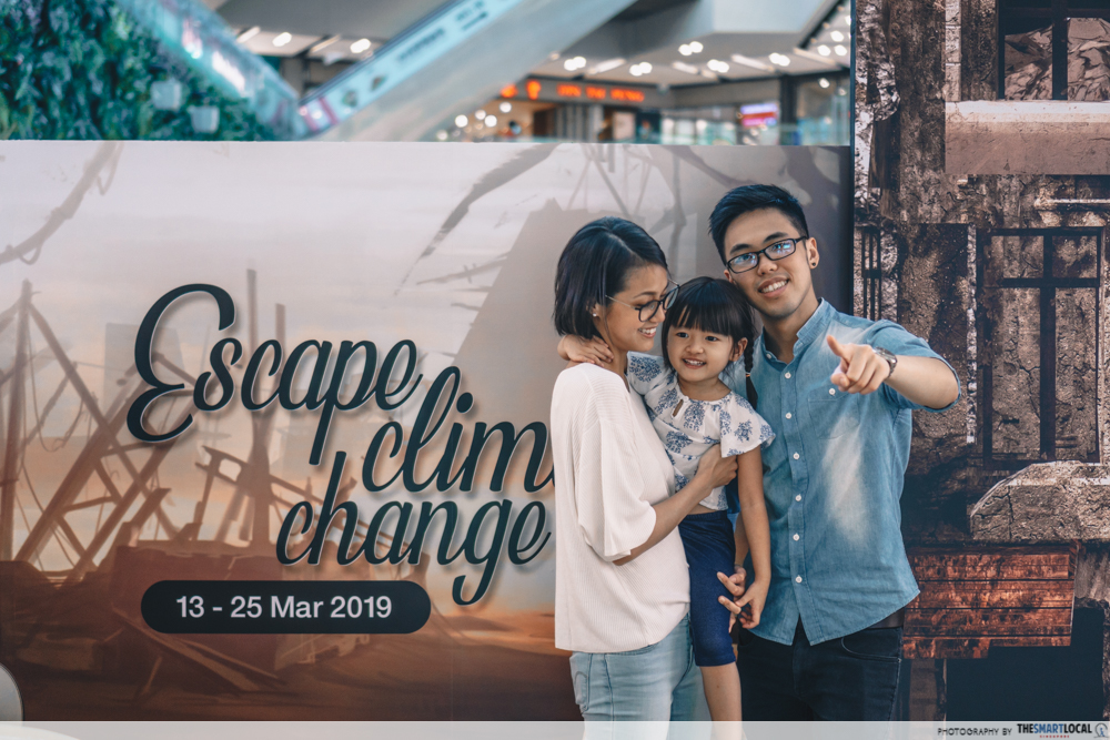 family at entrance of escape room