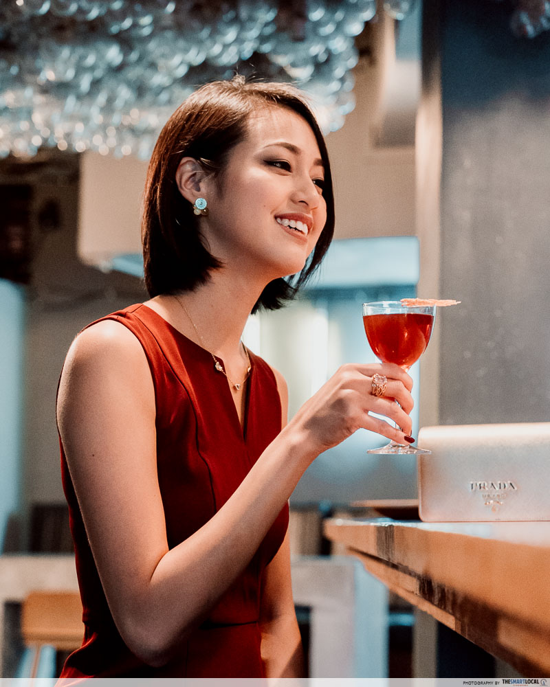 Lady holding cocktail at Operation Dagger