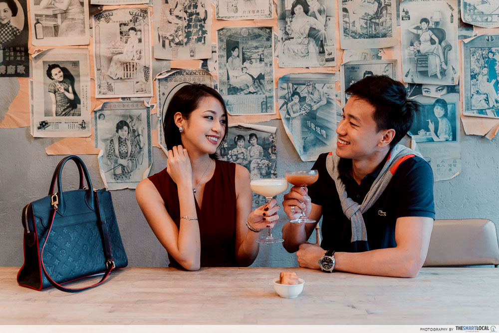 Couple toasting with Ah Sam Cold Drink Stall cocktails