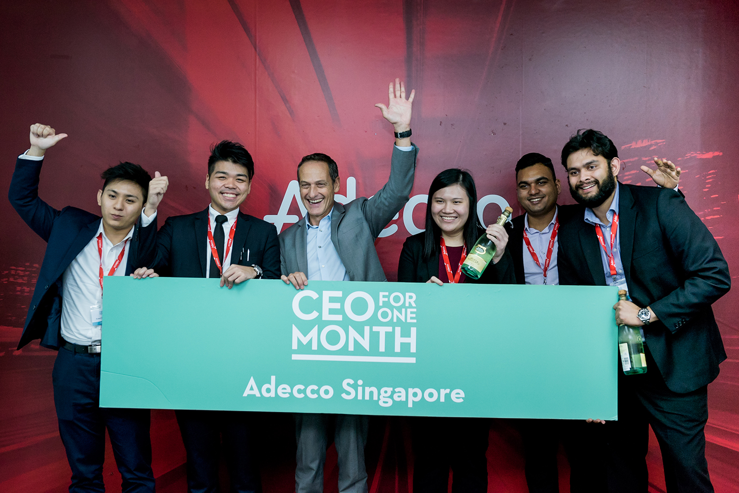 Adecco candidates holding a banner