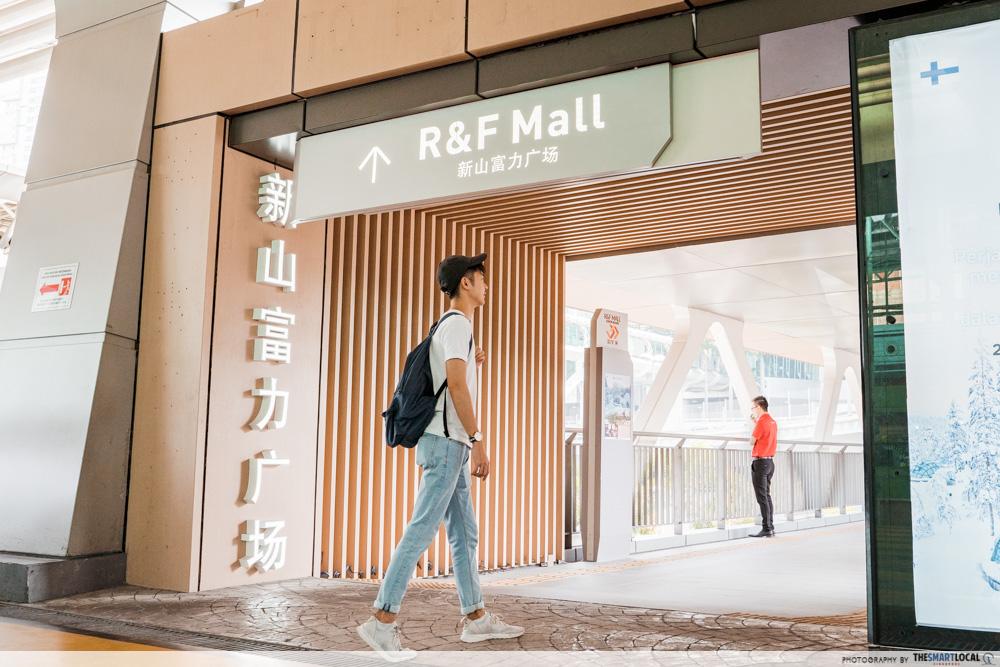 Guy walking into R&F Mall JB
