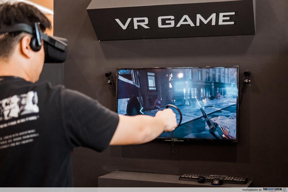 Guy playing VR Game