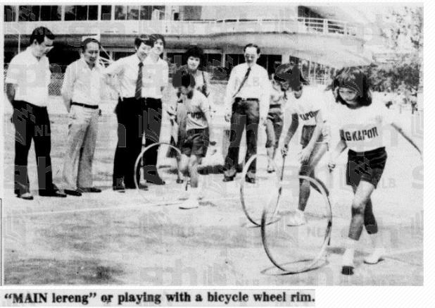 Traditional Singaporean games - Hoop Wheeling