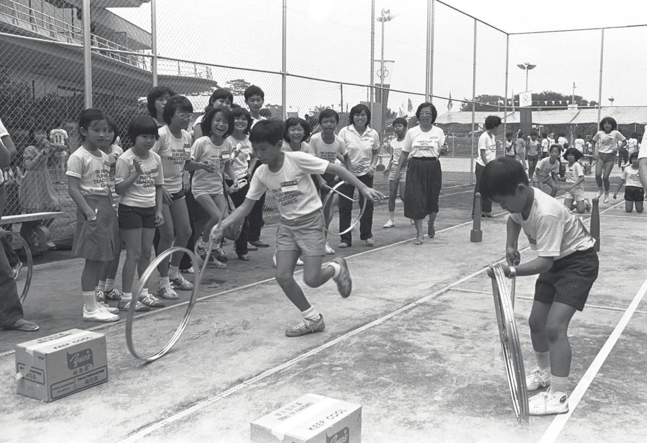Traditional Singaporean games - Hoop Wheeling