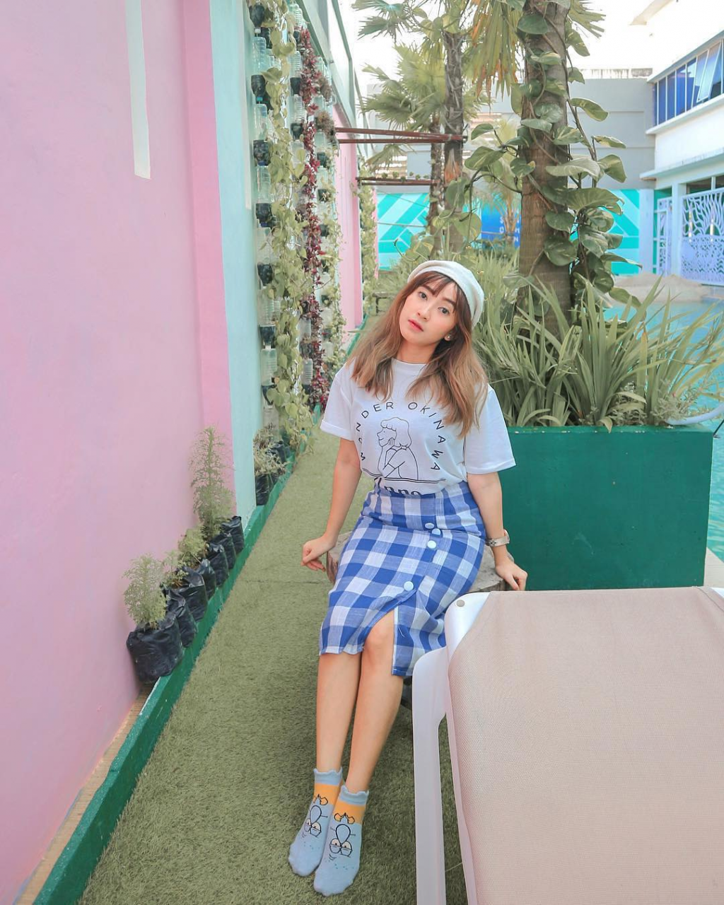 take your OOTD shots at the pastel walls beside the pool