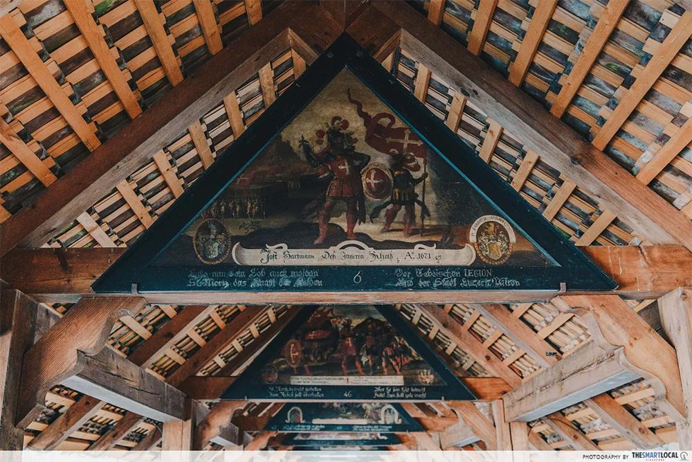 chapel bridge triangular paintings