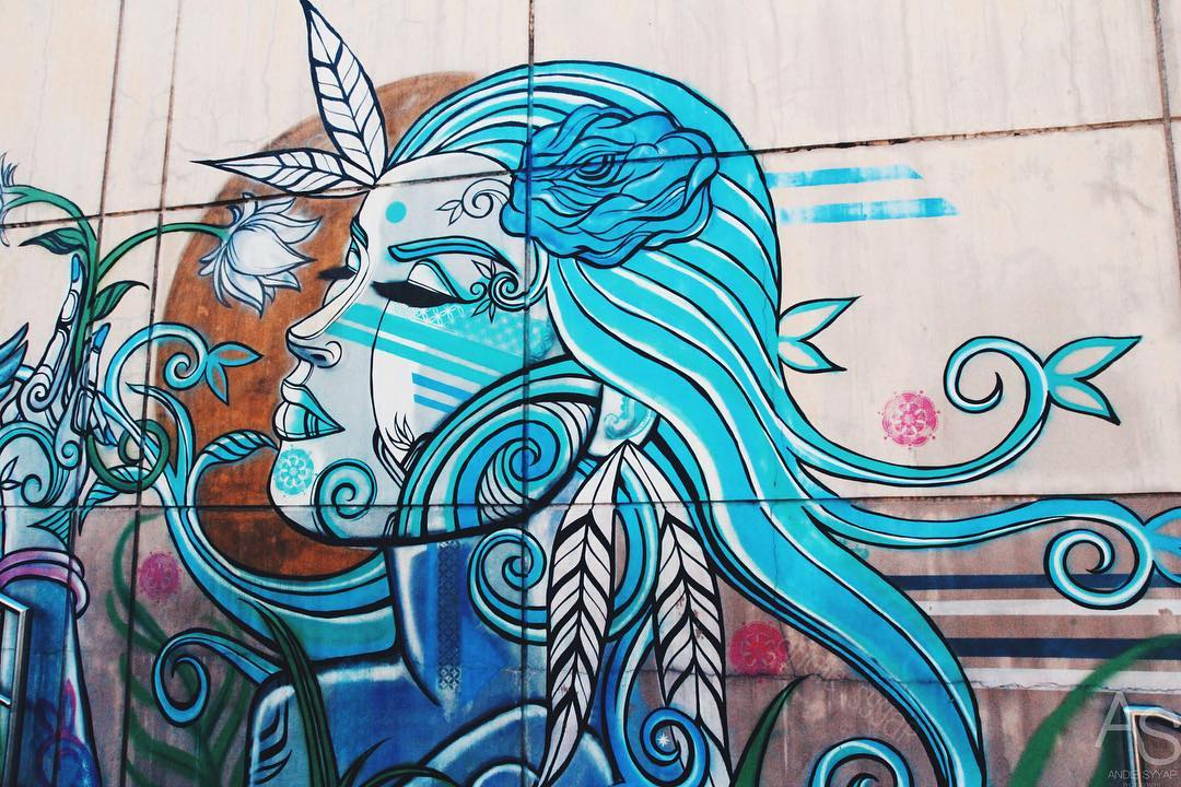bgc wall mural blue-themed woman