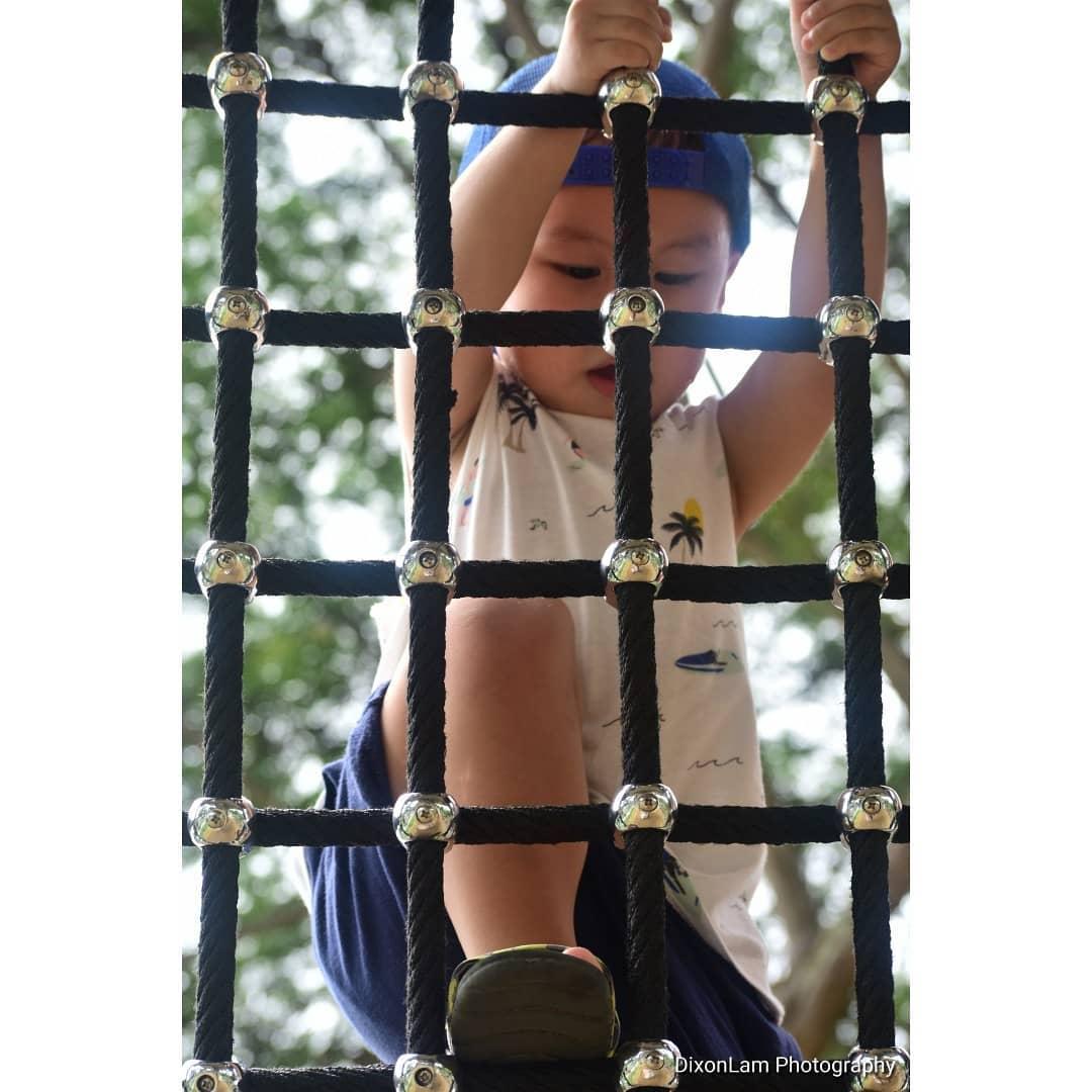 child on rope ladder
