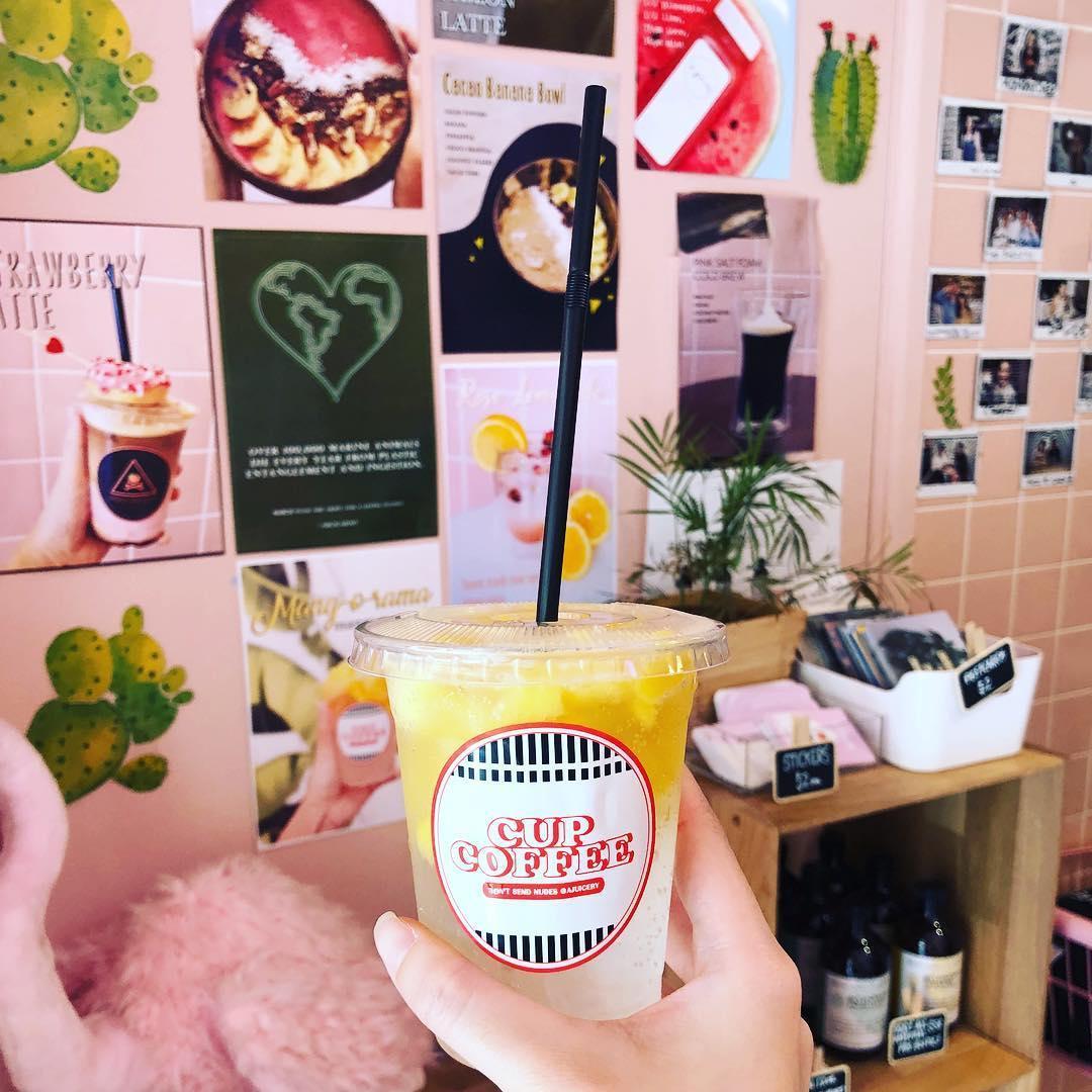 a juicery beverage cup coffee fruit juice
