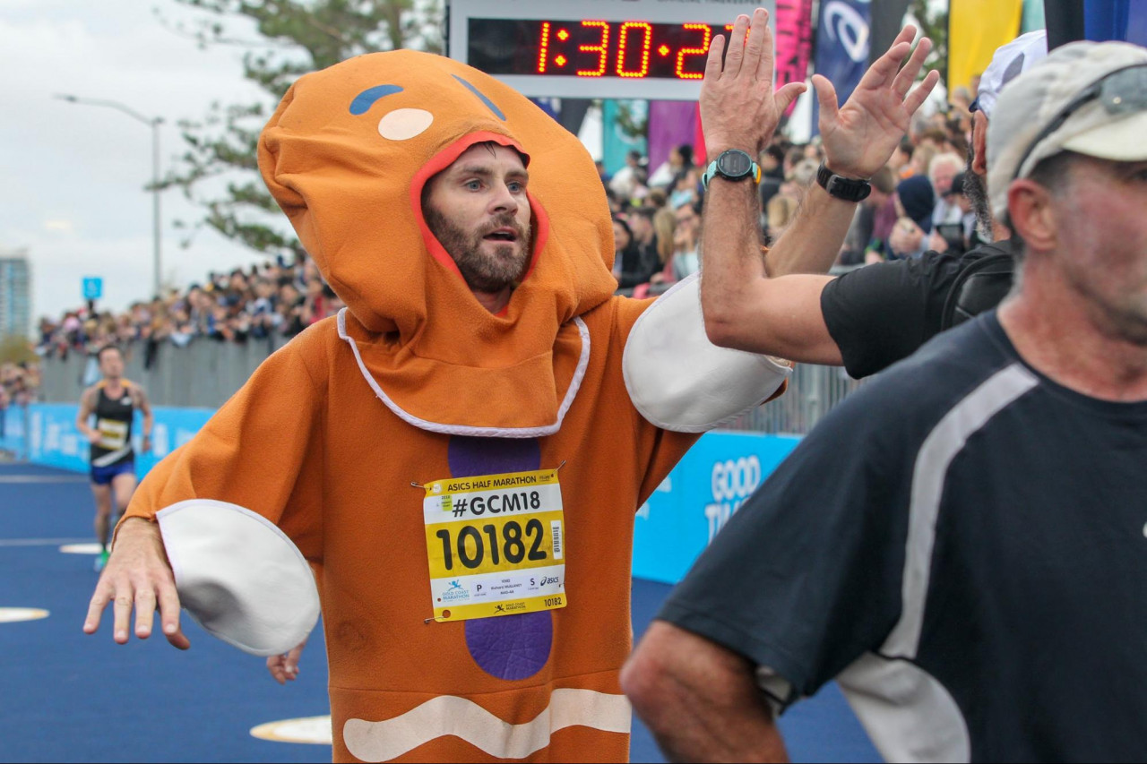 gold coast marathon racer in onesie