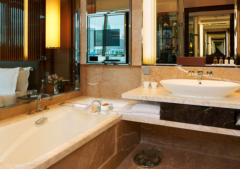fullerton bay hotel premier bay view rooms jacuzzi hot tub bathroom bath tub