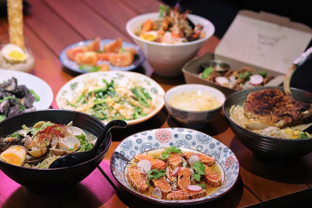 Assortment of sharing plates and mains at Super Ramen
