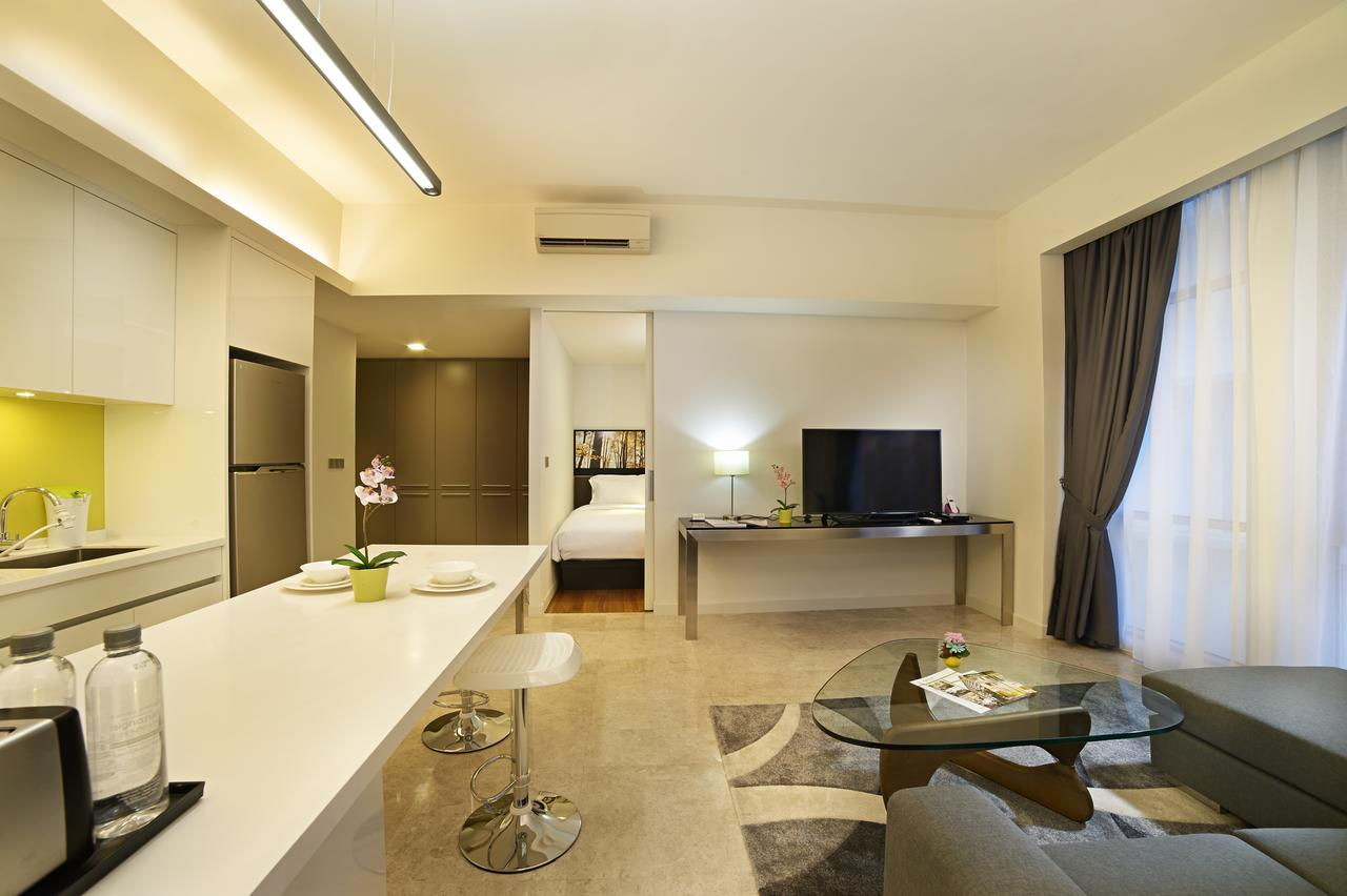 signature hotel and suites living room space