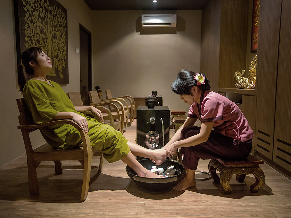 Lady having a foot scrub at Happy Feet