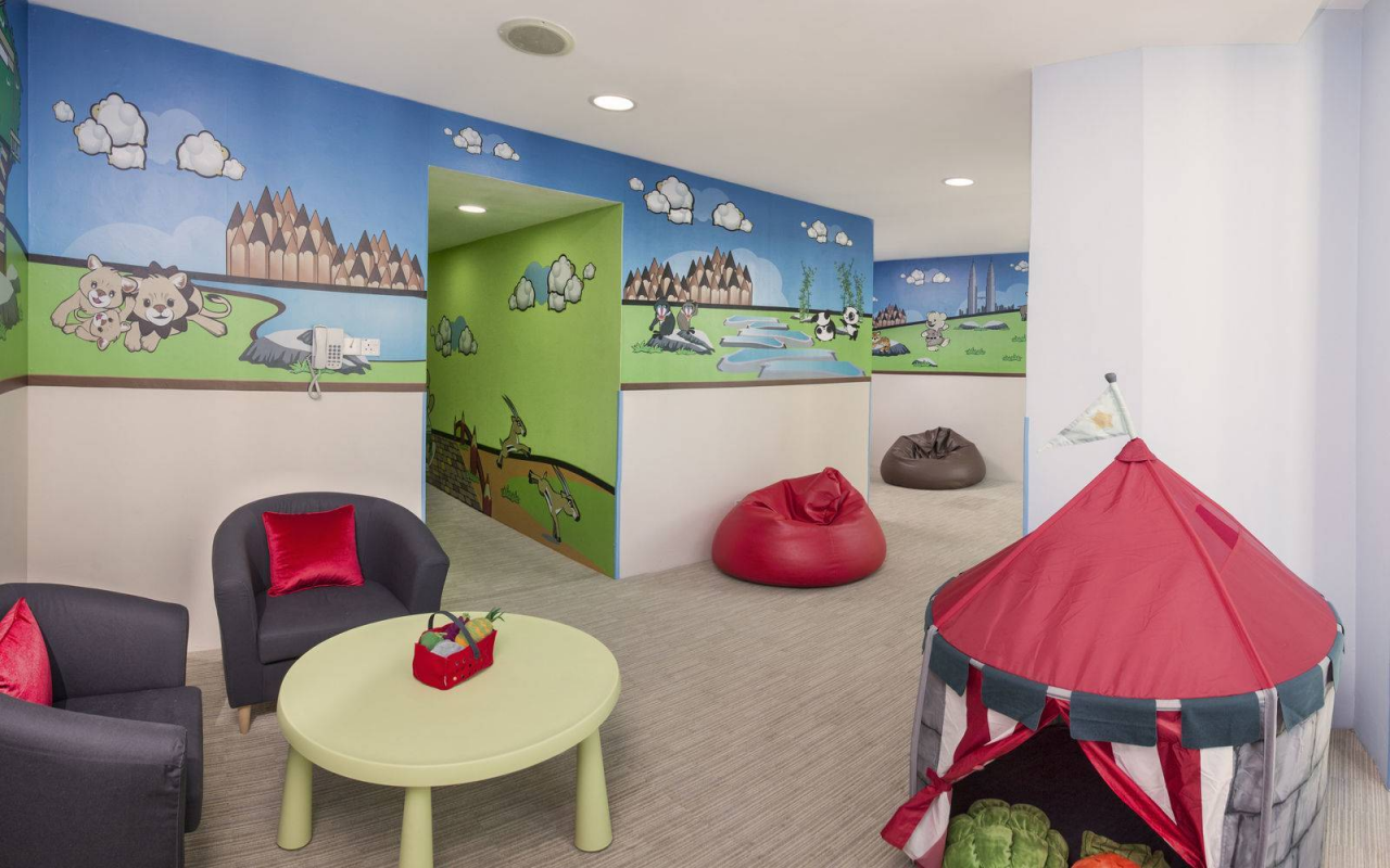 Play room with bean bags and tent at Ascott KL