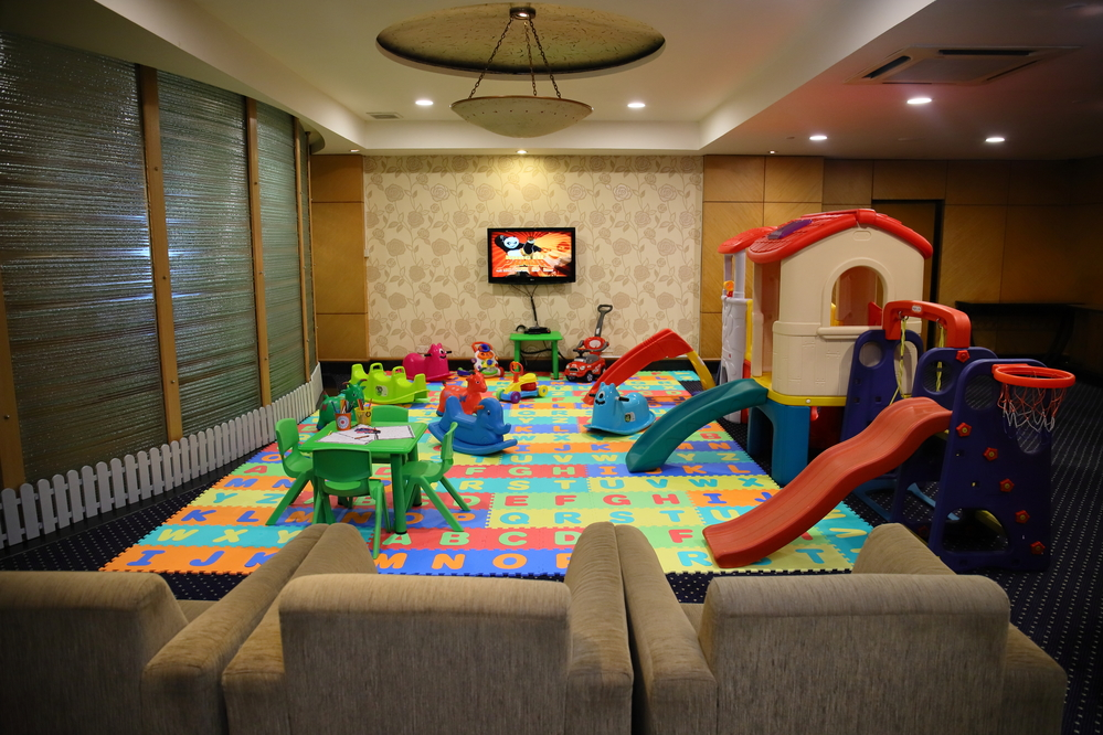Children's play room with sitting area at Sunway Putra Hotel