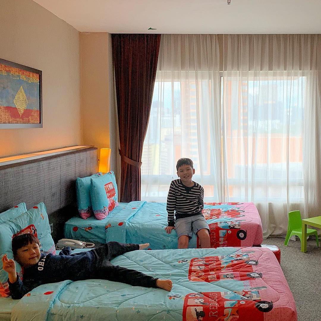 2 boys with kids' bed setup at Furama Bukit Bintang