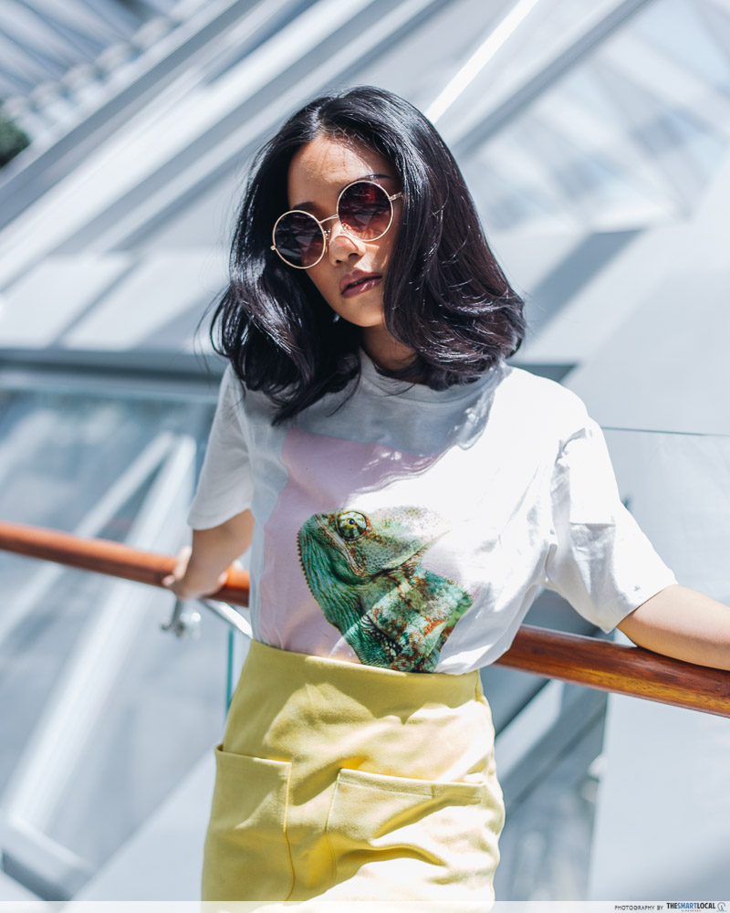 Girl wearing sunglasses, iguana tee and yellow skirt