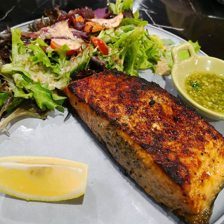 Charcoal grilled salmon at Homeground Grill and Bar