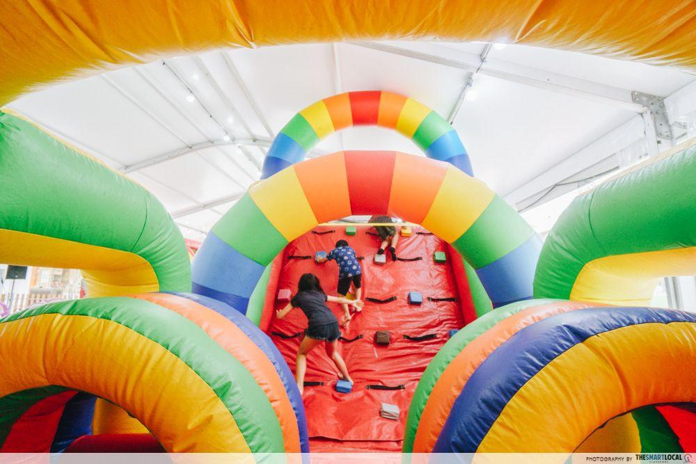 rainbow bouncy castle course vivocity carnival kids