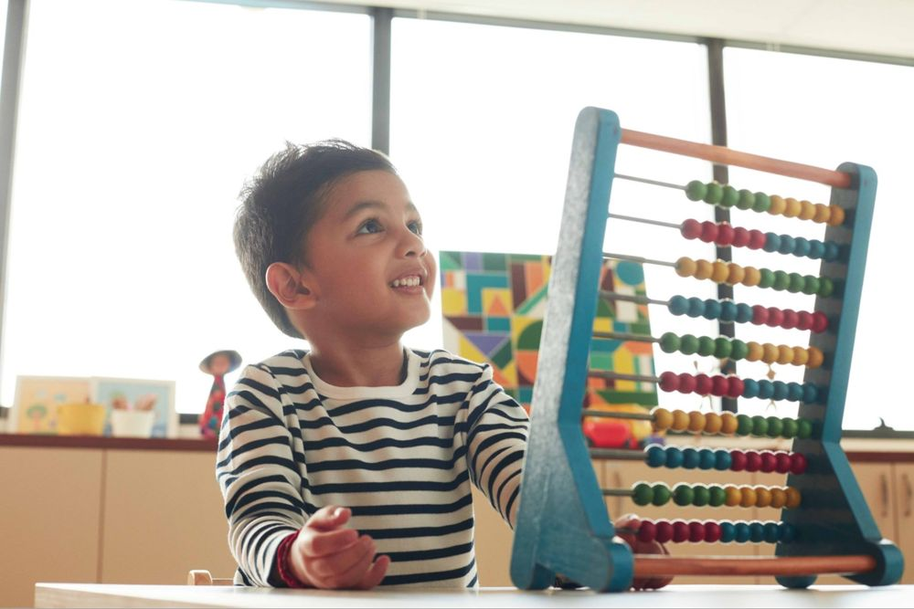 Child playing with abacus