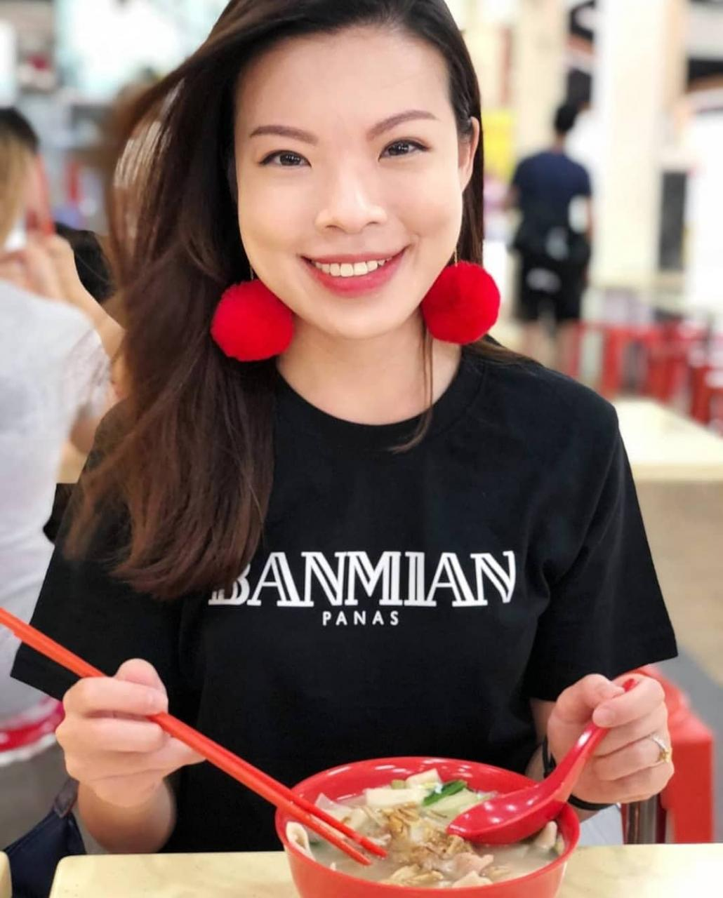 Girl eating Ban Mian wearing a Banmian shirt