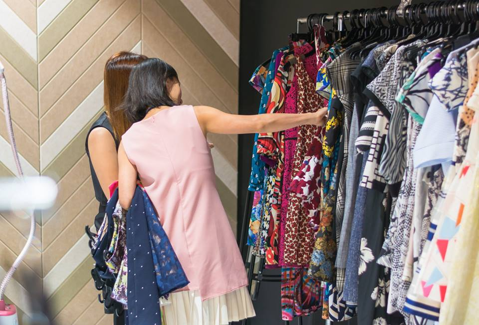 Women looking through clothes rack