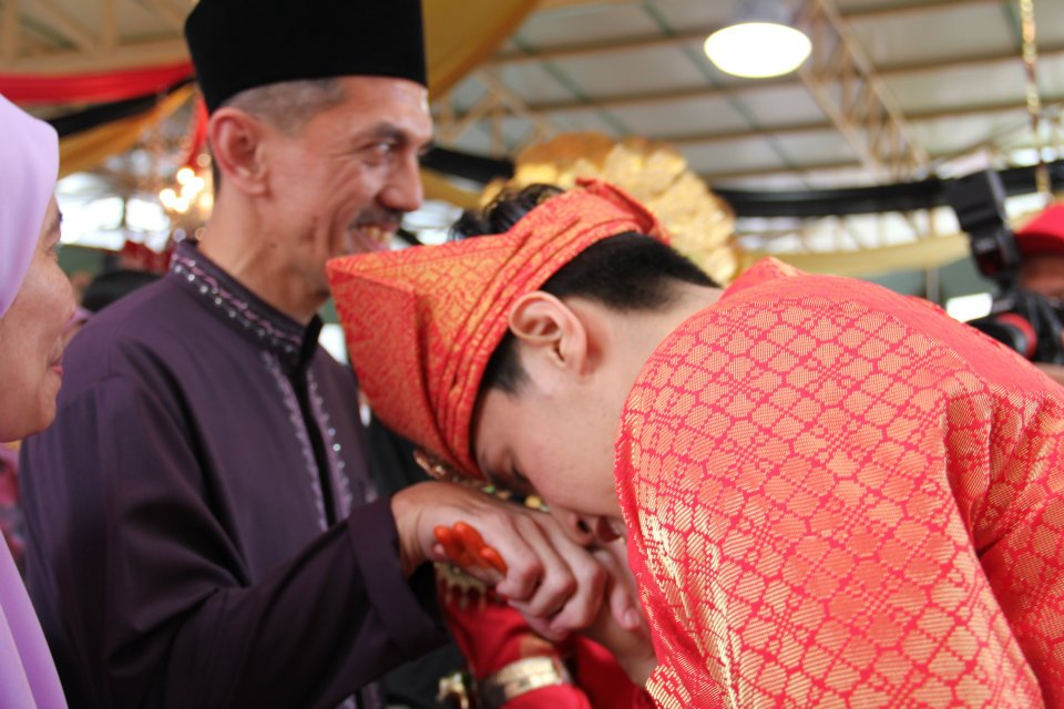 groom paying respect to elders