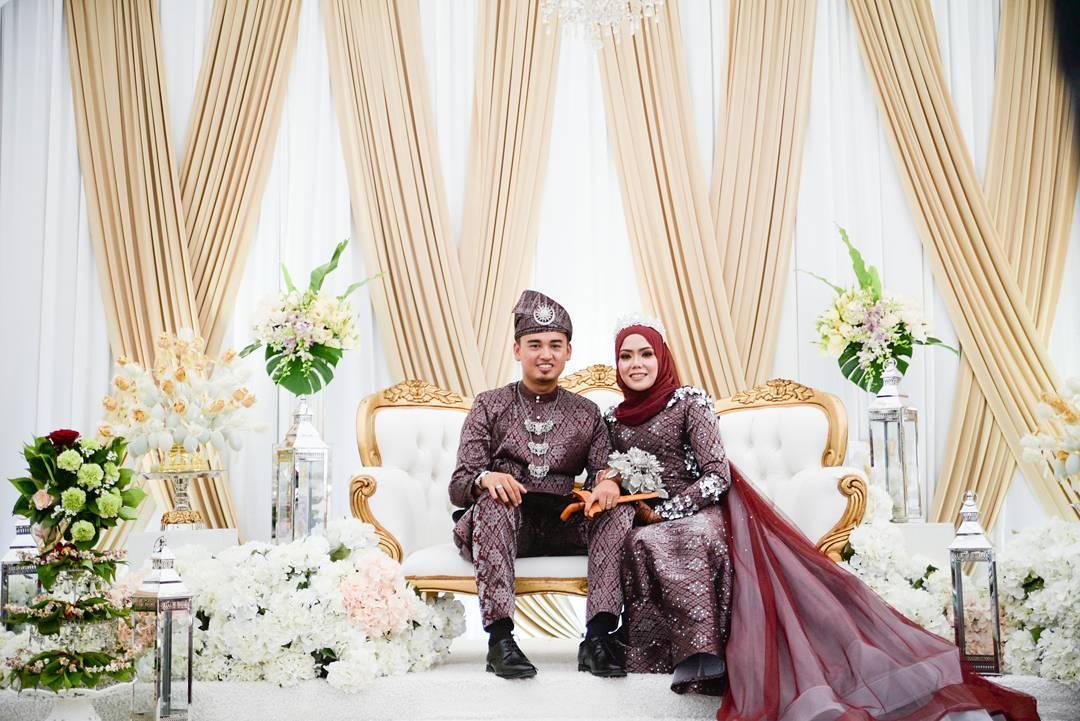 couple sitting on wedding dais