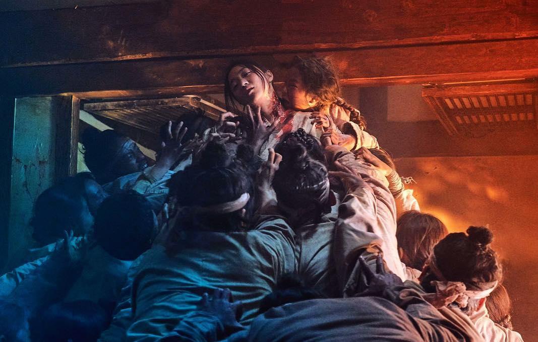 kingdom - zombies feeding on woman