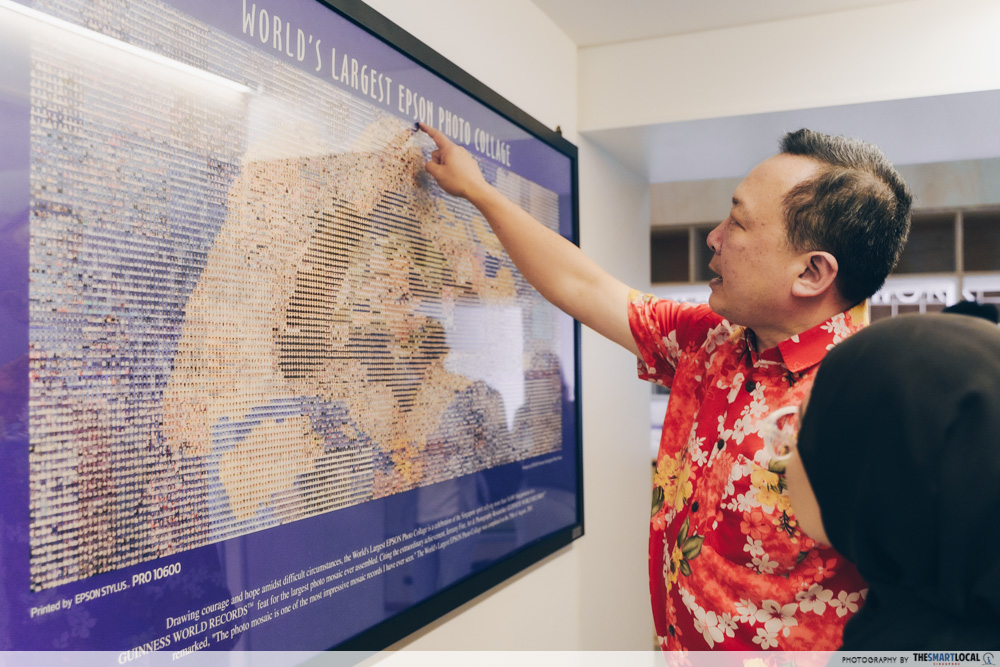 heartware network volunteer - mr raymond huang with photo frame of world's largest epson photo collage