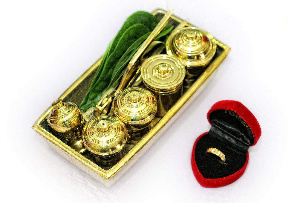 betel leaves on a gold tray with gold ring