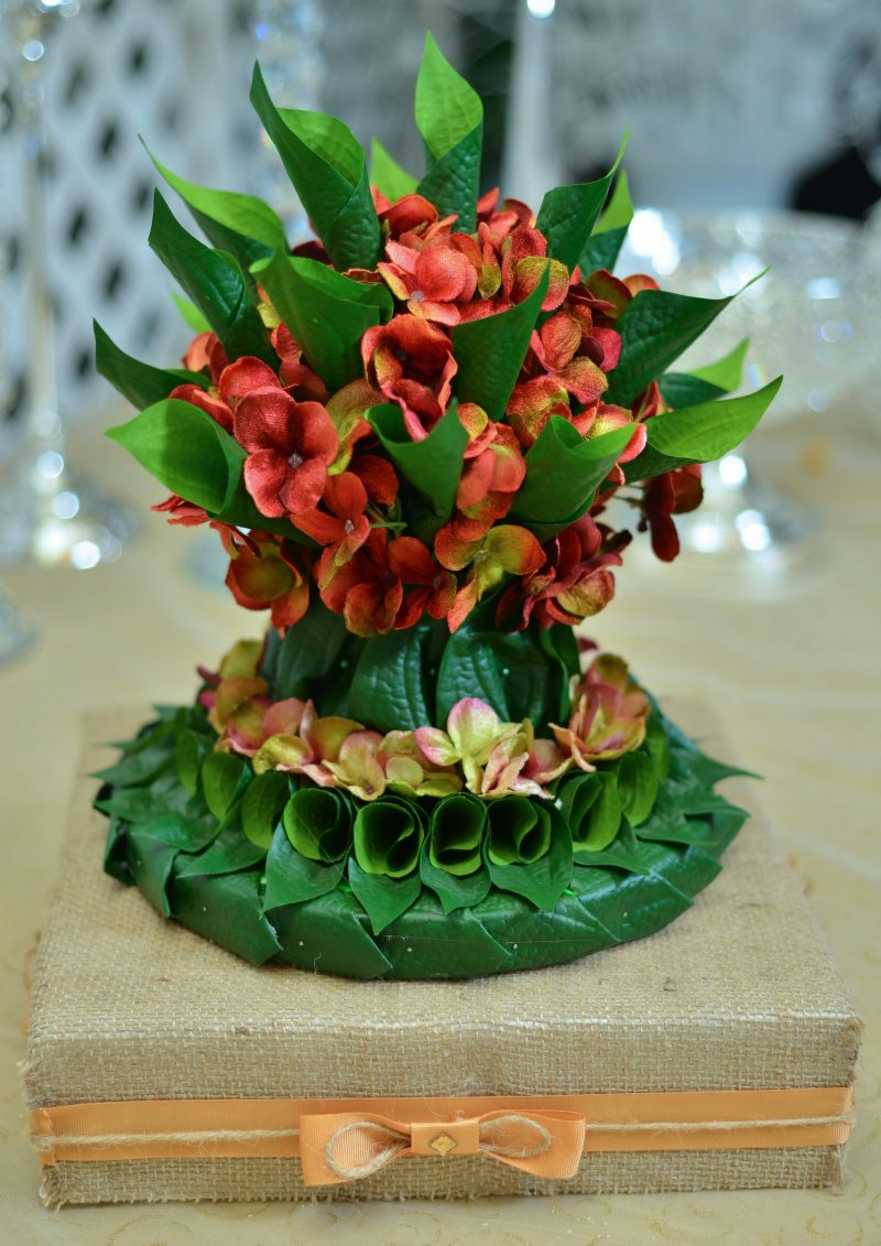 three-tiered arrangement of betel leaves