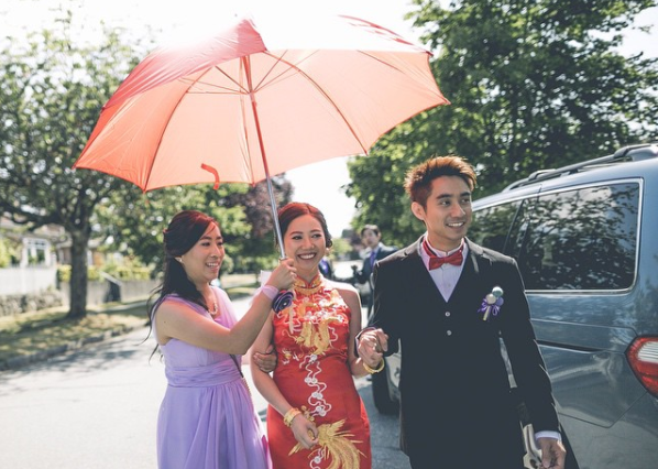 fetching bride with red umbrella