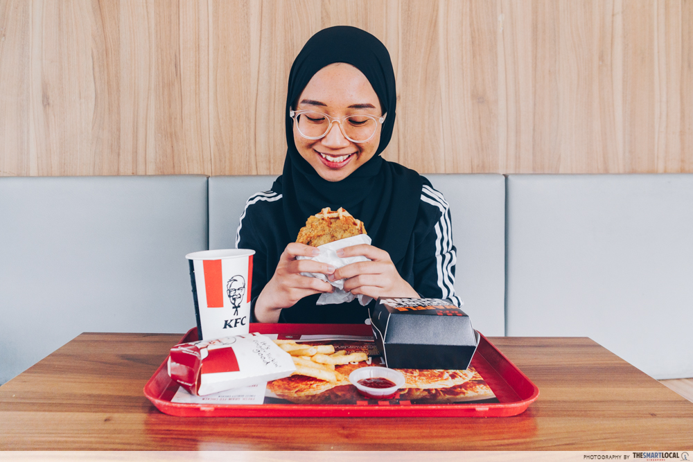 KFC waffle double down - person eating the meal