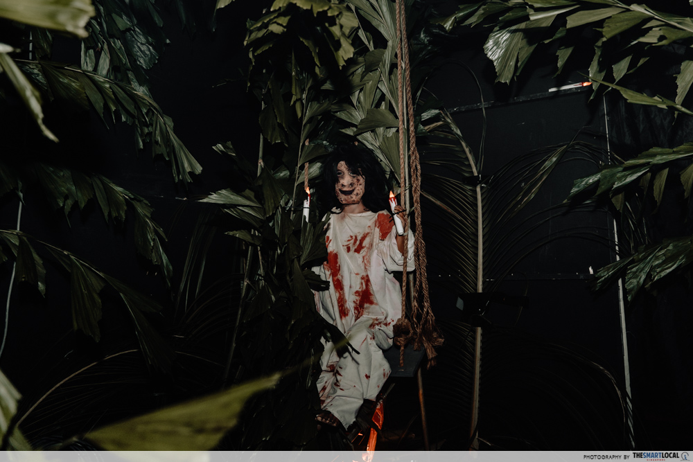 cathay horror haunt - pontianak sitting on a swing