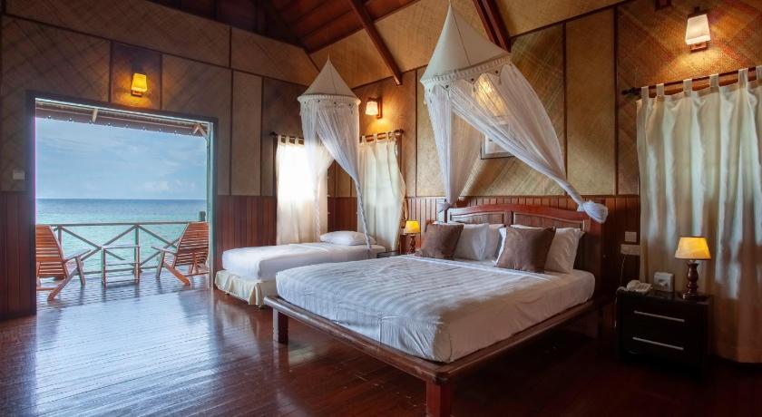 kota kinabalu resorts and hotels - water chalet room at lankayan island dive resort