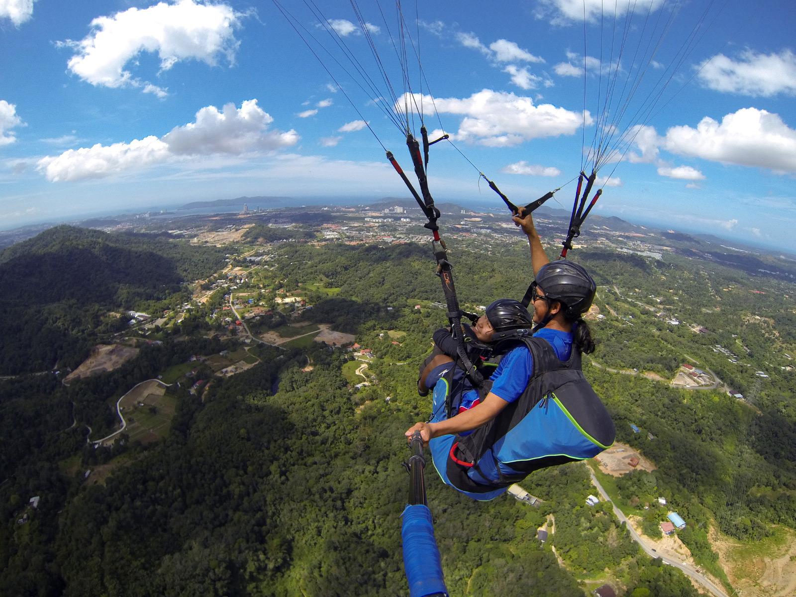 kota kinabalu resorts and hotels - paragliding over kota kinabalu