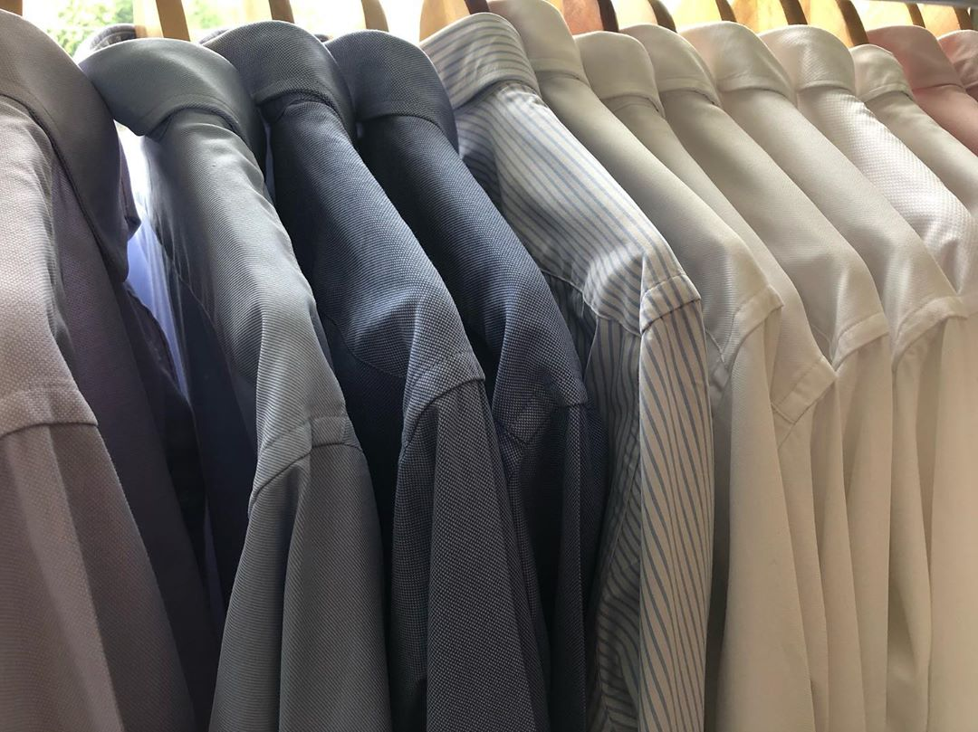 laundry tips - rack of collared shirts