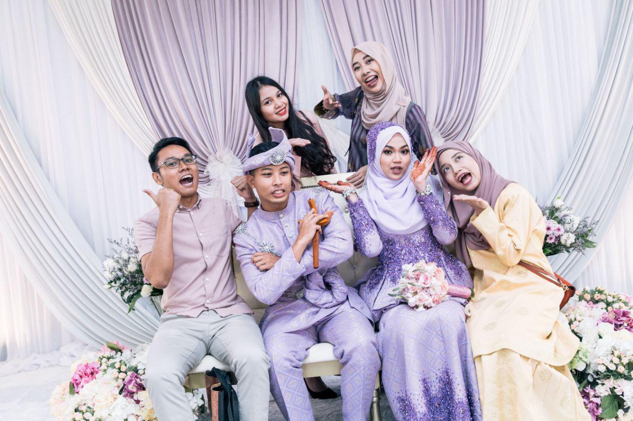 malay wedding - friends on wedding dais