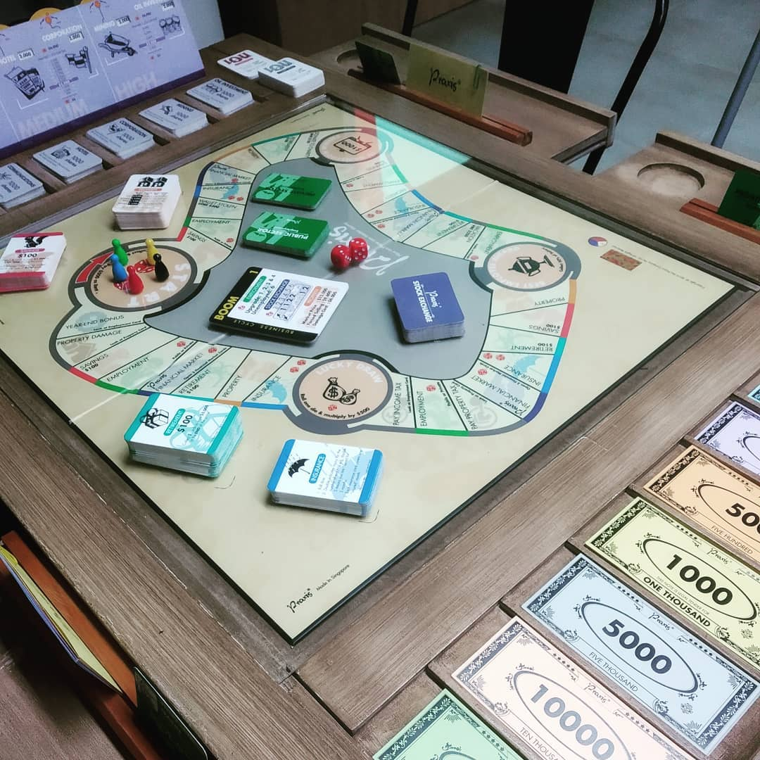 learning neighbourhood at geylang serai - the praxis board game to learn personal finance