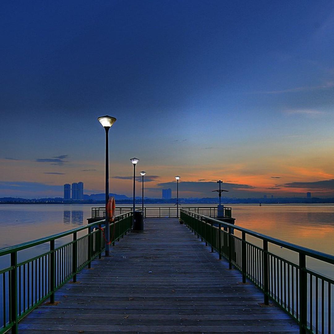 sunrise and sunset in singapore - sembawang jetty