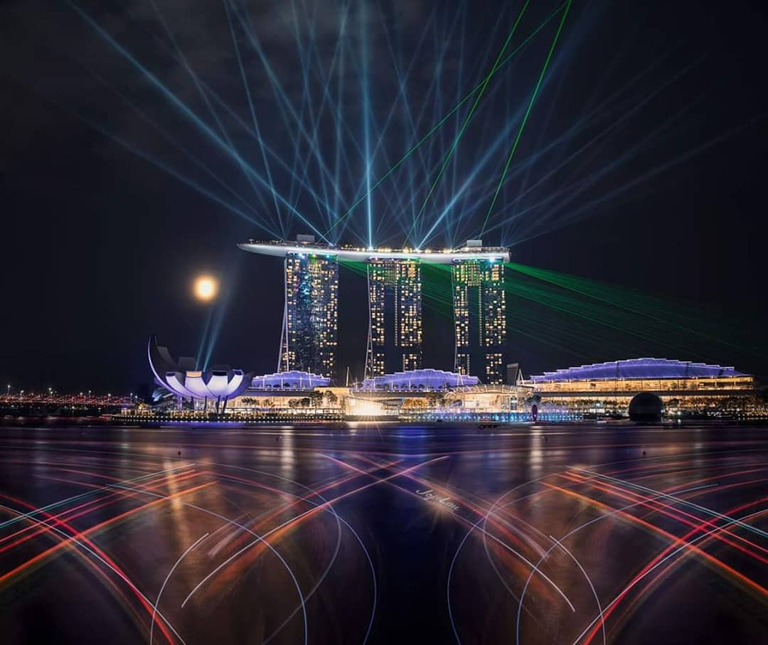 sunrise and sunset in singapore - marina bay sands light and water show