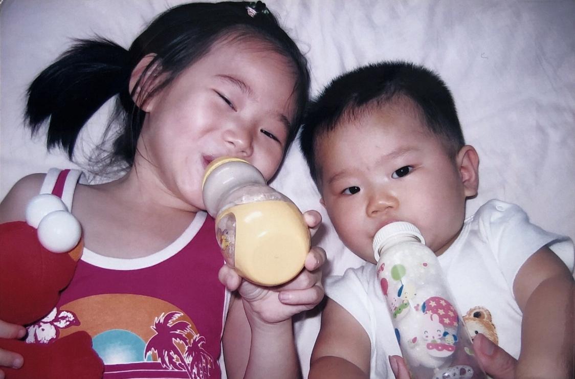 siblings drinking milk