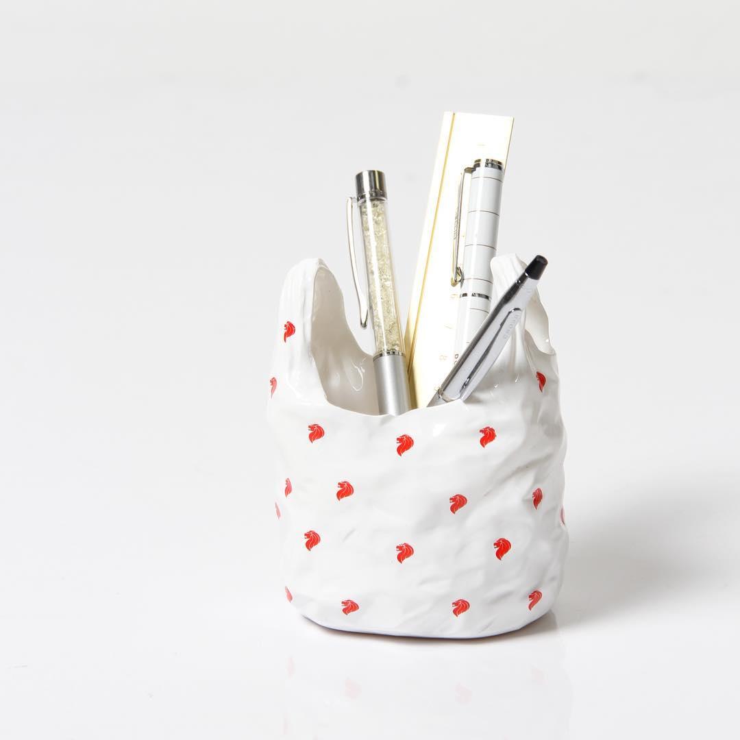 Plastic bag pen holder